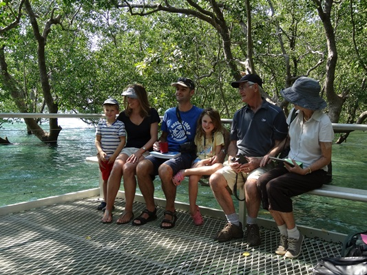 Three generations of bird watchers absorbing the serenity of the mangroves